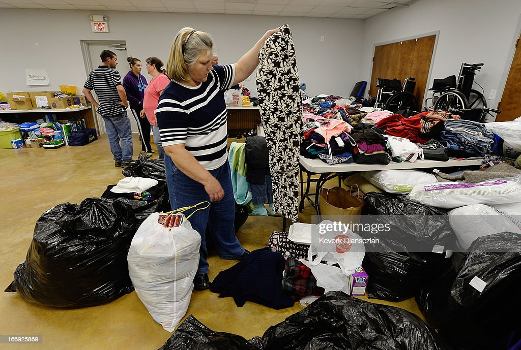 Jackie Arias picks up donated clothing at Veterans of Foreign Wars Post 4819 after her house was damaged April 18, 2013 in West, Texas. A fiery explosion that damaged or destroyed buildings within a half-mile radius ripped through the facility last night, injuring more than 160 people and killing an unknown number of others.