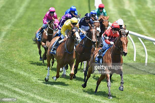 Jackie Beriman riding Danestroem leads around the back straight before winning Race 4 during Melbourne Racing at Sandown Racecourse on December 5...