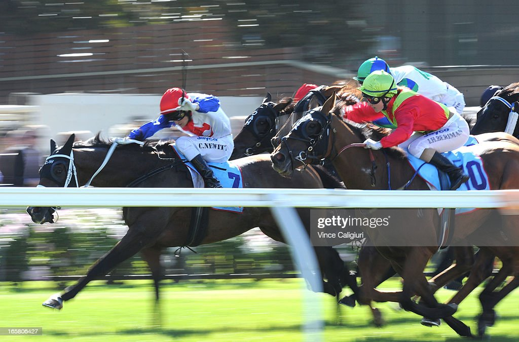Jackie Beriman riding Vittoria (10) gets up on the fence to win the Friends Of Epworth Handicap during Melbourne racing at Moonee Valley Racecourse on April 6, 2013 in Melbourne, Australia.