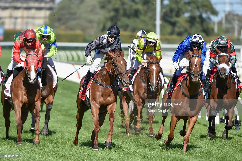 Jackie Beriman riding Written (L) defeats Nicholas Hall riding Fast Approaching in Race 9 during Melbourne Racing at Caulfield Racecourse on February 6, 2016 in Melbourne, Australia.