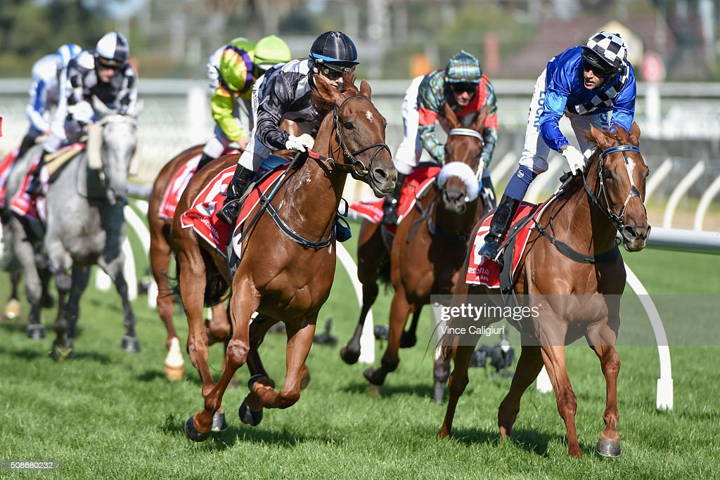 Jackie Beriman riding Written defeats Nicholas Hall riding Fast Approaching (r) in Race 9 during Melbourne Racing at Caulfield Racecourse on February 6, 2016 in Melbourne, Australia.