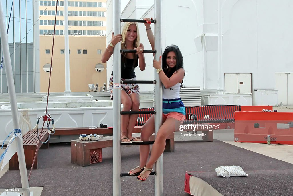 L-R Jackie Bianchi and Olivia Blois Sharpe performs on trapeze at Trump Taj Mahal on July 6, 2012 in Atlantic City, New Jersey.