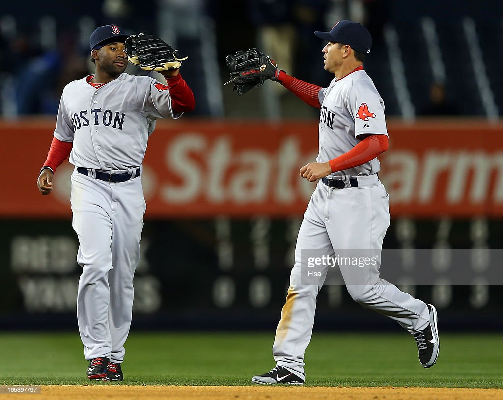 Jackie Bradley #44 and <a gi-track='captionPersonalityLinkClicked' href=/galleries/search?phrase=Jacoby+Ellsbury&family=editorial&specificpeople=4172583 ng-click='$event.stopPropagation()'>Jacoby Ellsbury</a> #2 of the Boston Red Sox celebrate the win over the New York Yankees on April 3, 2013 at Yankee Stadium in the Bronx borough of New York City.The Boston Red Sox defeated the New York Yankees 7-4.