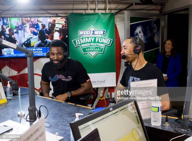 Jackie Bradley Jr #19 and Mookie Betts of the Boston Red Sox speak on air at the Jimmy Fund Radio Telethon booth at Fenway Park for an interview on...
