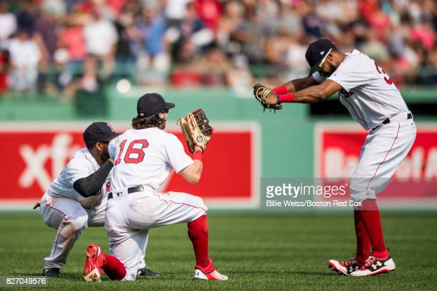 Jackie Bradley Jr #19 Andrew Benintendi and Chris Young of the Boston Red Sox celebrate a victory against the Chicago White Sox on August 6 2017 at...