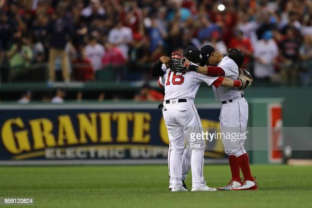 Jackie Bradley Jr #19 Andrew Benintendi and Mookie Betts of the Boston Red Sox celebrate defeating the Houston Astros 103 in game three of the...