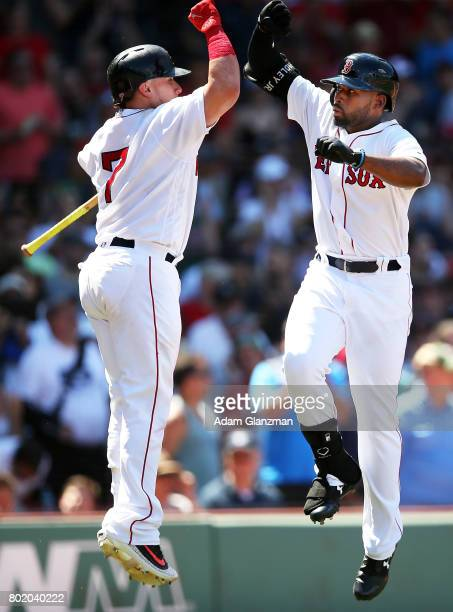 Jackie Bradley Jr #19 high fives Christian Vazquez of the Boston Red Sox after hitting a solo home run in the fifth inning of a game against the Los...