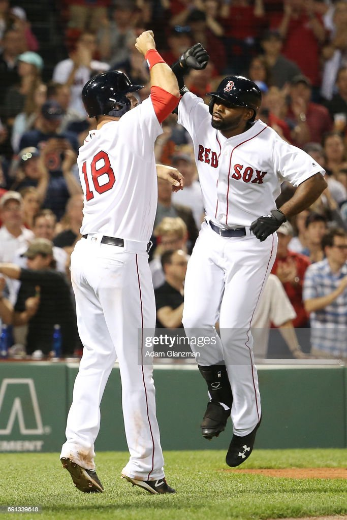 Jackie Bradley Jr. #19 high fives Mitch Moreland #18 of the Boston Red Sox after hitting a three run home-run in the eighth inning of a game against the Detroit Tigers at Fenway Park on June 9, 2017 in Boston, Massachusetts.