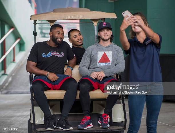 Jackie Bradley Jr #19 Mookie Betts and Andrew Benintendi of the Boston Red Sox pose for a photo with a fan before a game against the St Louis...