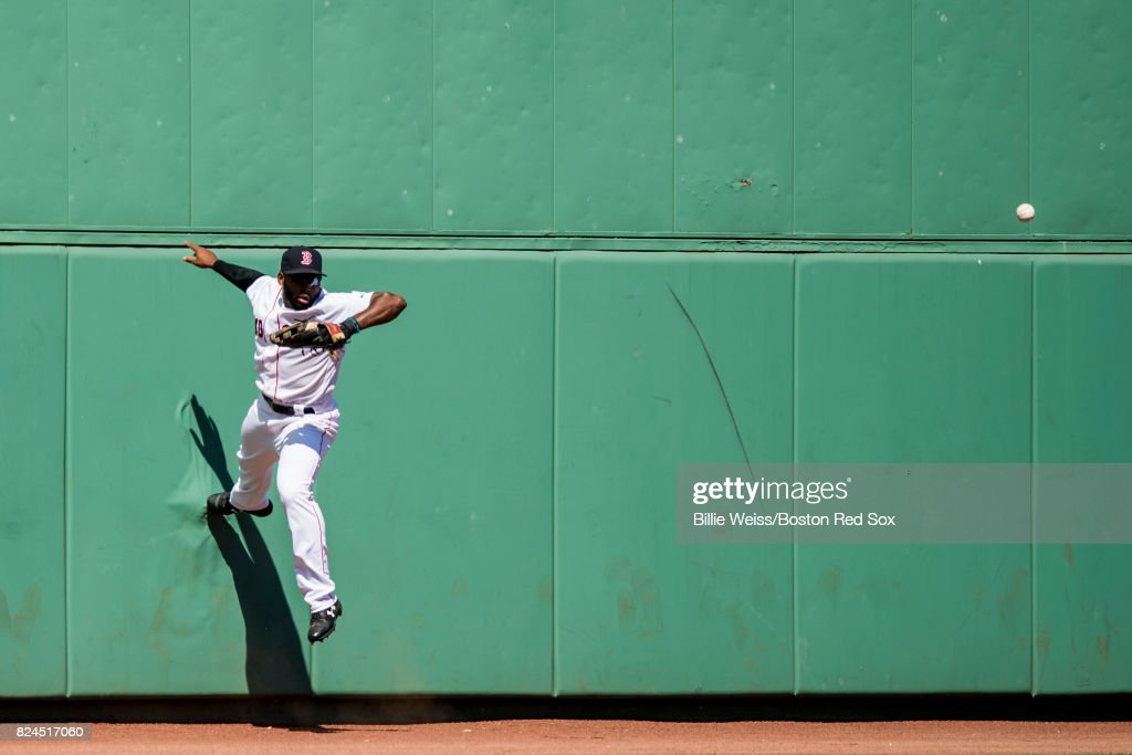 Jackie Bradley Jr. #19 of the Boston Red Sox attempts to catch a line drive off of the wall during the sixth inning of a game against the Kansas City Royals on July 30, 2017 at Fenway Park in Boston, Massachusetts.