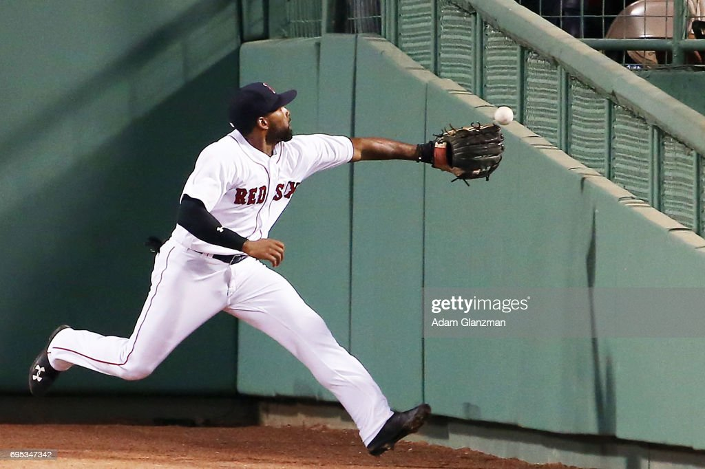 Jackie Bradley Jr. #19 of the Boston Red Sox can't come up with a fly ball during a game against the Detroit Tigers at Fenway Park on June 11, 2017 in Boston, Massachusetts.