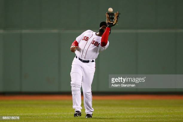 Jackie Bradley Jr #19 of the Boston Red Sox catches a fly ball during a game against the Chicago Cubs at Fenway Park on April 30 2017 in Boston...