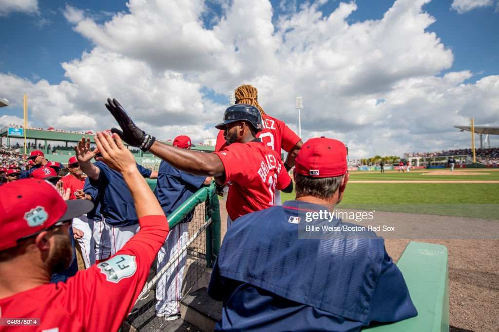 Jackie Bradley Jr. #19 of the Boston Red Sox high fives teammates after scoring during the second inning of a Spring Training game against the New York Yankees on February 28, 2017 at Fenway South in Fort Myers, Florida .