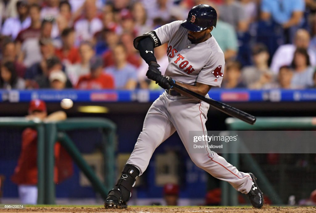 Jackie Bradley Jr. #19 of the Boston Red Sox hits a single in the seventh inning against the Philadelphia Phillies at Citizens Bank Park on June 15, 2017 in Philadelphia, Pennsylvania. The Phillies won 1-0.