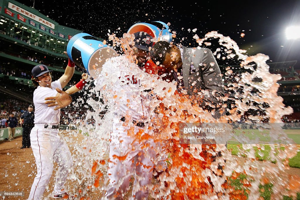 Jackie Bradley Jr. #19 of the Boston Red Sox is showered in Powerade while being interviewed by NESN sideline reporter Jahmai Webster after the victory over the Detroit Tigers at Fenway Park on June 9, 2017 in Boston, Massachusetts.