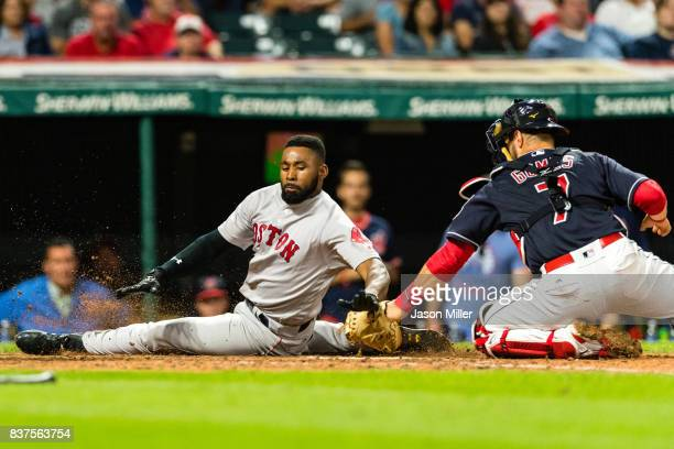 Jackie Bradley Jr #19 of the Boston Red Sox scores on a double by Eduardo Nunez as catcher Yan Gomes of the Cleveland Indians tries to make the tag...
