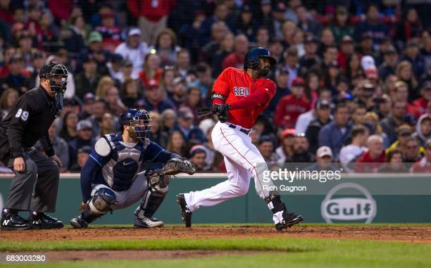 Jackie Bradley Jr #19 of the Boston Red Sox swings at a pitch during the third inning of a game against the Tampa Bay Rays at Fenway Park on May 12...