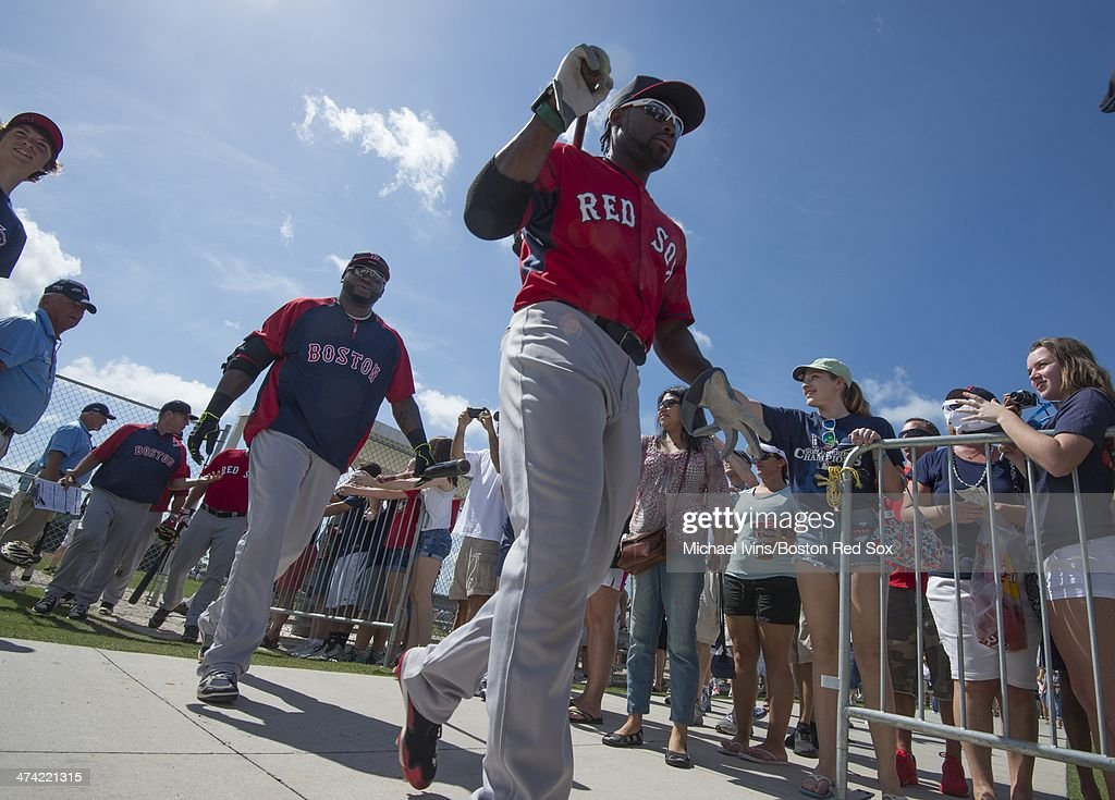 Jackie Bradley Jr. #25 and David Ortiz #34 of the Boston Red Sox walk pass fans as they switch fields during a Spring Training workout at Fenway South on February 22, 2014 in Fort Myers, Florida.
