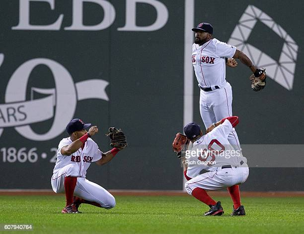 Jackie Bradley Jr #25 of the Boston Red Sox celebrates a 54 win against the New York Yankees with teammates Mookie Betts and Chris Young at Fenway...