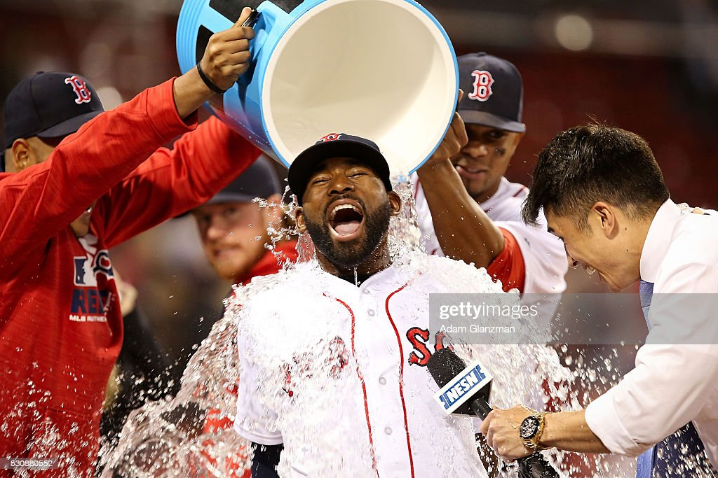 Jackie Bradley Jr. #25 of the Boston Red Sox has Powerade dumped on him after the victory over the Oakland Athletics at Fenway Park on May 11, 2016 in Boston, Massachusetts.
