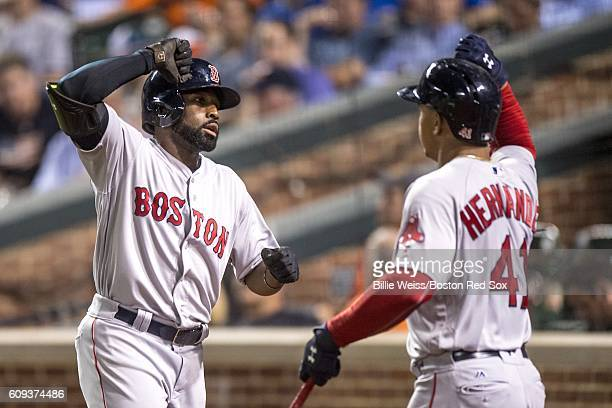 Jackie Bradley Jr #25 of the Boston Red Sox high fives Marco Hernandez after hitting a solo home run during the fourth inning of a game against the...