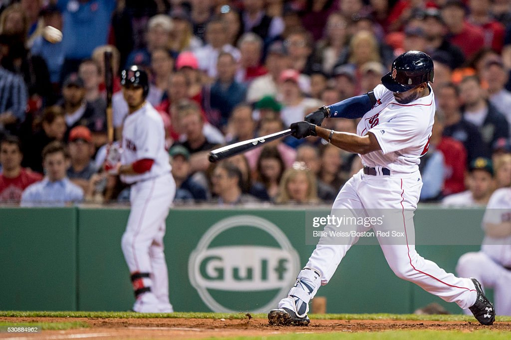 Jackie Bradley Jr. #25 of the Boston Red Sox hits an RBI double during the fifth inning of a game against the Oakland Athletics on May 11, 2016 at Fenway Park in Boston, Massachusetts.
