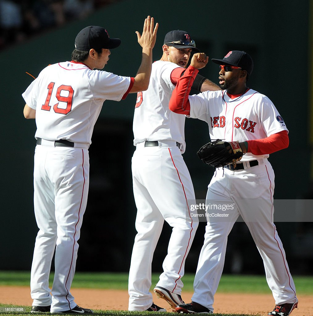 Jackie Bradley Jr., #25 of the Boston Red Sox slaps high fives with teamates Will MIddlebrooks #16 and <a gi-track='captionPersonalityLinkClicked' href=/galleries/search?phrase=Koji+Uehara&family=editorial&specificpeople=801278 ng-click='$event.stopPropagation()'>Koji Uehara</a> #19 following their win against the Toronto Blue Jays at Fenway Park on September 22, 2013 in Boston, Massachusetts. The Red Sox won the game 5-2