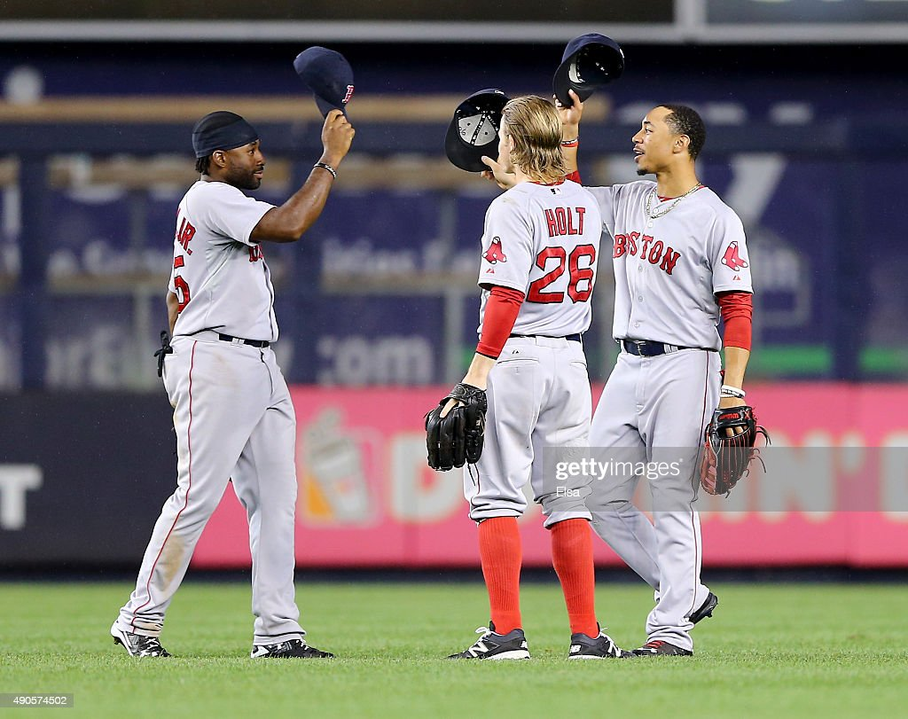 Jackie Bradley Jr #25Brock Holt and Mookie Betts of the Boston Red Sox celebrate the win over the New York Yankees on September 29 2015 at Yankee...