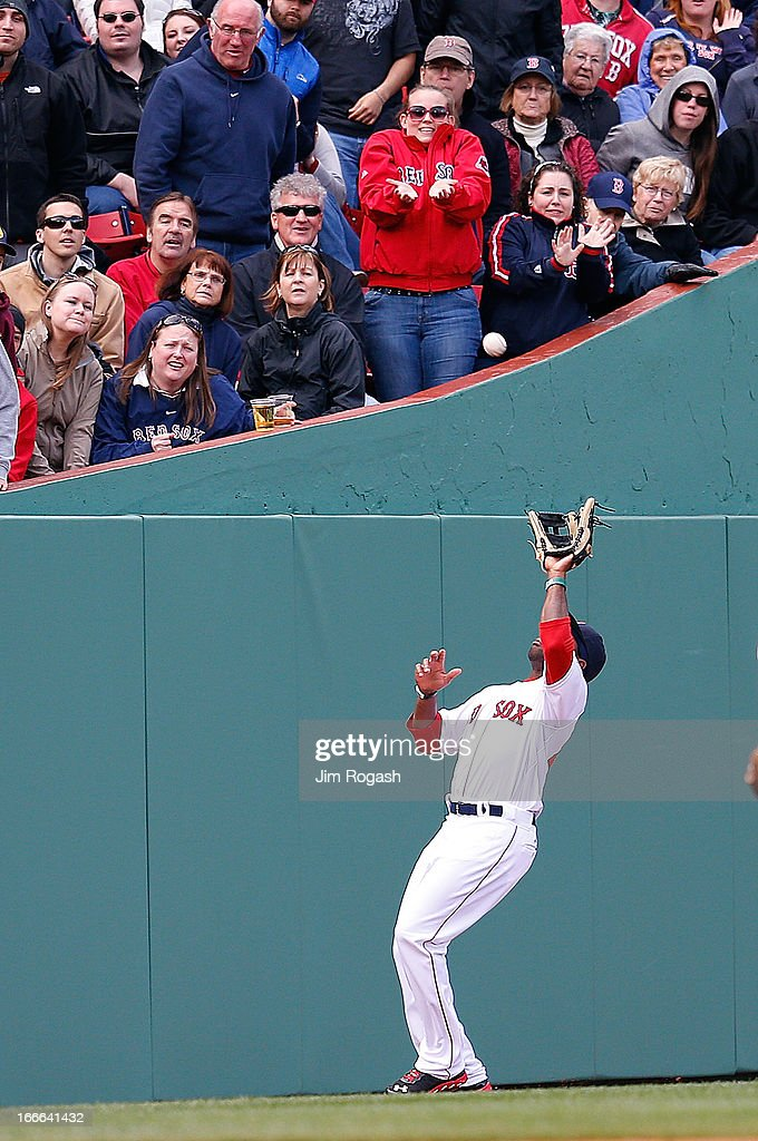 Jackie Bradley Jr. #44 of the Boston Red Sox makes a catch in left field in the seventh inning one ball hit by Ben Zobrist #18 of the Tampa Bay Rays for the final out of the inning at Fenway Park on April 14, 2013 in Boston, Massachusetts.