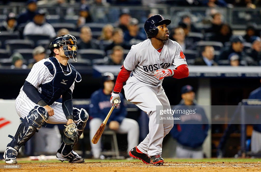 Jackie Bradley #44 of the Boston Red Sox follows through on a seventh inning RBI double against the New York Yankees at Yankee Stadium on April 4, 2013 in the Bronx borough of New York City. The Yankees defeated the Red Sox 4-2.
