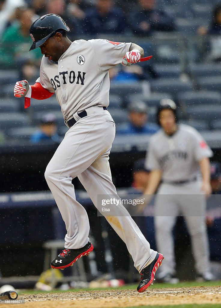 Jackie Bradley #44 of the Boston Red Sox scores a run in the ninth inning against the New York Yankees during Opening Day on April 1, 2013 at Yankee Stadium in the Bronx borough of New York City.
