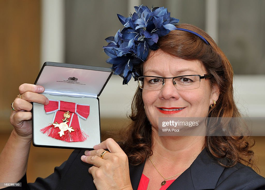 Jackie Brock-Doyle proudly holds her OBE award after the Investiture Ceremony at Buckingham Palace on March 07, 2013 in London, England.