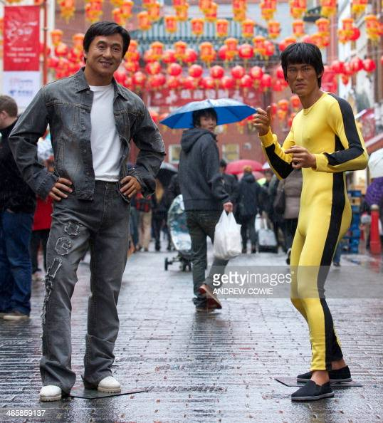 jackie chan l and bruce lee wax figures are displayed
