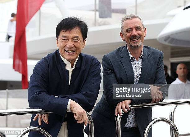 Jackie Chan and director Sam Fell attend the photocall for 'Skiptrace' at The 66th Annual Cannes Film Festival on May 16 2013 in Cannes France