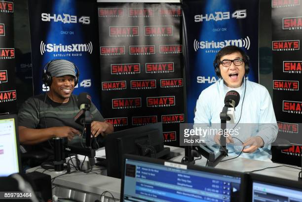 Jackie Chan enjoys a moment with host Swya Calloway during at visit to 'Sway in the Morning' at SiriusXM Studios on October 10 2017 in New York City