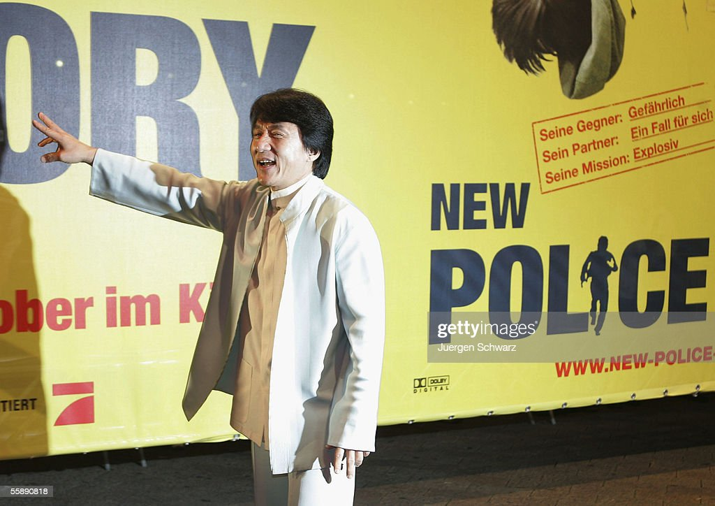 Jackie Chan gestures he arrives for the German premiere of New Police Story October 10, 2005 at the Cinedom in Cologne, Germany.