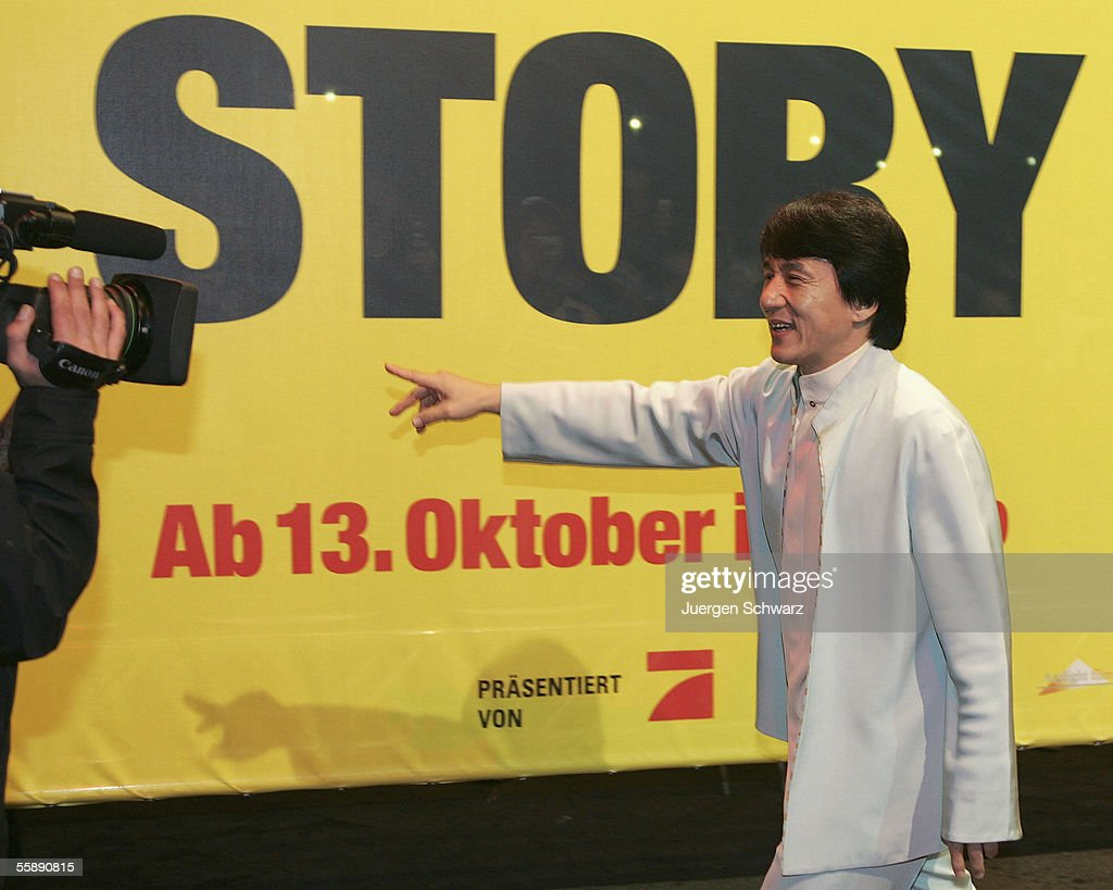 Jackie Chan gestures in front of a tv camera when he arrives for the German premiere of New Police Story October 10, 2005 at the Cinedom in Cologne, Germany.