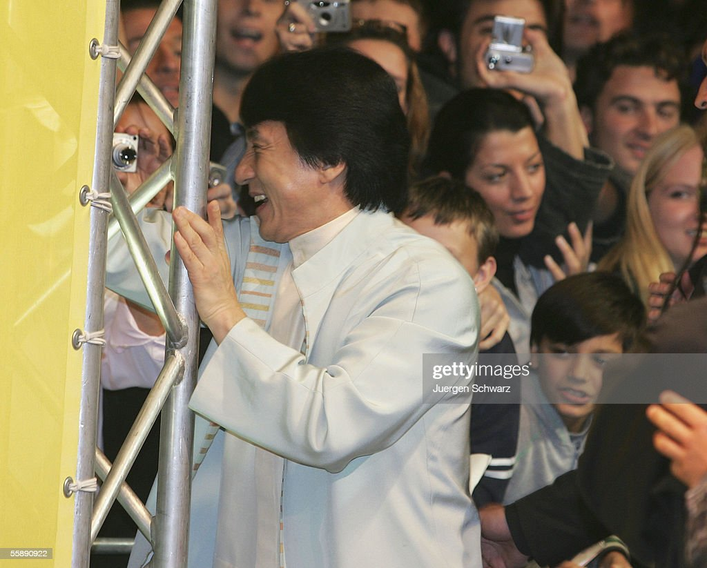 Jackie Chan stands close to supporters when he arrives for the German premiere of New Police Story October 10, 2005 at the Cinedom in Cologne, Germany.