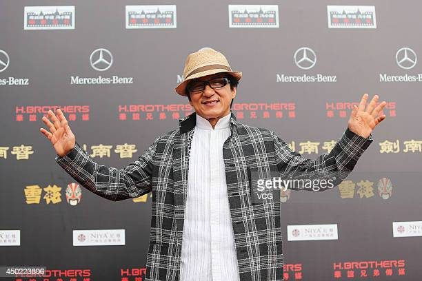 Jackie Chan walks the red carpet at the Huayi Brothers 20th Anniversary Ceremony on June 7 2014 in Haikou Hainan Province of China