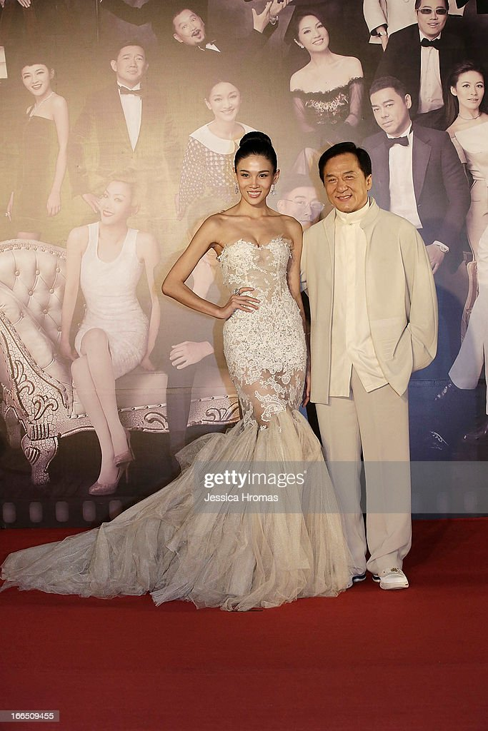 <a gi-track='captionPersonalityLinkClicked' href=/galleries/search?phrase=Jackie+Chan&family=editorial&specificpeople=171455 ng-click='$event.stopPropagation()'>Jackie Chan</a> (R) with actress Zhang Lanxin on the red carpet at the 2013 Hong Kong Film Awards on April 13, 2013 in Hong Kong, Hong Kong.