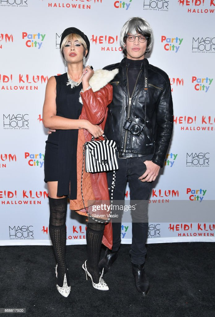 Jackie Cruz (L) and Fernando Garcia attend Heidi Klum's 18th annual Halloween Party presented by Party City at the Magic Hour Rooftop Bar & Lounge on October 31, 2017 in New York City.