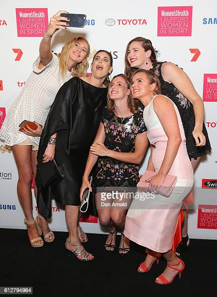 Jackie Frank and Cate Campbell and Bronte Campbell take a selfie ahead of the Women's Health I Support Women In Sport Awards at Carriageworks on...