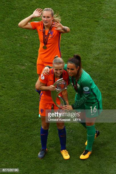 Jackie Groenen and Angela Christ nd00 celebrates with the lifts the trophy on the podium after winning after the Netherlands v Denmark UEFA Women's...