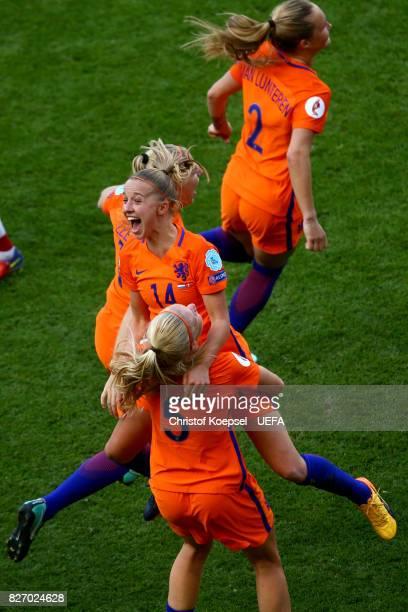 Jackie Groenen and Kika van Es of the Netherlands celebrate winning the EURO after the Netherlands v Denmark UEFA Women's Euro 2017 Final at De...