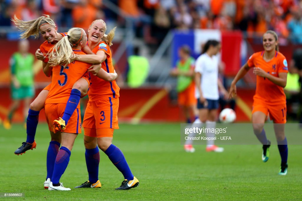 Jackie Groenen, Kika van Es and Stephanie van der Gragt of the Netherlands celebrate after winning 1-0 the UEFA Women's Euro 2017 Group A match between Netherlands and Norway at Stadion Galgenwaard on July 16, 2017 in Utrecht, Netherlands.