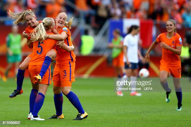Jackie Groenen Kika van Es and Stephanie van der Gragt of the Netherlands celebrate after winning 10 the UEFA Women's Euro 2017 Group A match between...