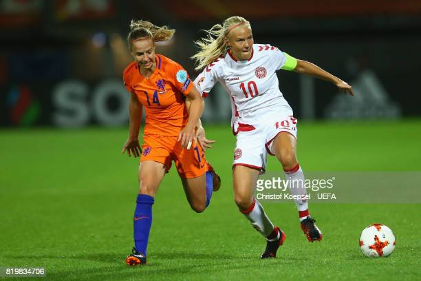 Jackie Groenen of the Netherlands challenges Pernille Harder of Denmark during the UEFA Women's Euro 2017 Group A match between Netherlands and...