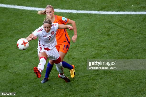 Jackie Groenen of the Netherlands challenges Sanne Troelsgaard of Denmark during the Netherlands v Denmark UEFA Women's Euro 2017 Final at De Grolsch...