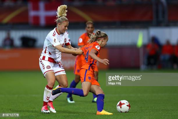 Jackie Groenen of The Netherlands holds off pressure from Mie Jans of Denmark during the UEFA Women's Euro 2017 Group A match between Netherlands and...