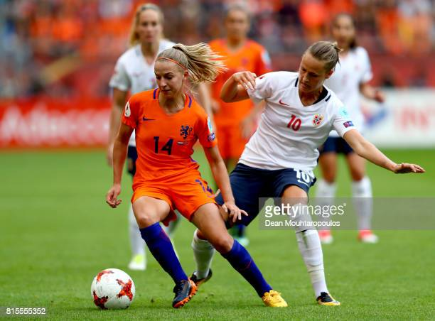 Jackie Groenen of the Netherlands is tackled by Caroline Graham Hansen of Norway during the Group A match between Netherlands and Norway during the...